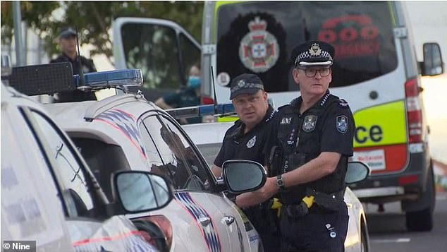 Queensland police at the crime scene on Sunday. Police said Codey Eig told them: 'I hope the c**t dies' and 'I shanked the s**t out of him'. The court case continues