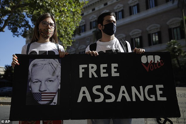 Demonstrators held up signs outside the Old Bailey, while inside, Julian Assange told a judge he did not consent to extradition