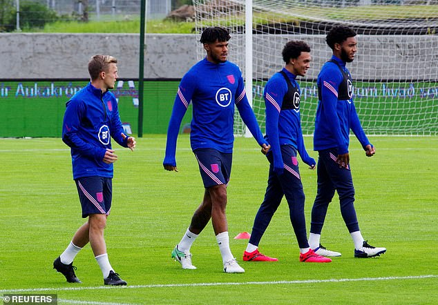 England's players walk out onto the training pitch, before they travel on to Copenhagen