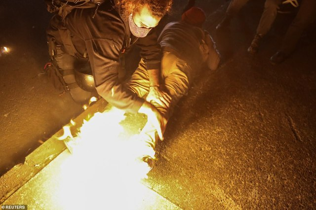During the 100th night of protest in Portland, a man's shoes caught on fire after some people launched Molotov cocktails into roadways