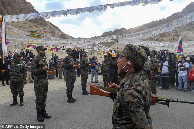 Indian soldiers pay their respects during the funeral of their comrade, Tibetan-origin India's special forces soldier Nyima Tenzin in Leh on September 7