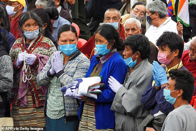 Relatives attend the funeral of Tibetan-origin India's special forces soldier Nyima Tenzin in Leh on September 7