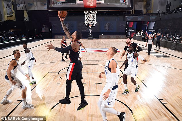 The treatment of employees is a far cry from how Disney runs the NBA Bubble in Florida, where athletes are tested daily and monitored for symptoms.  The Portland Trail Blazers play against the Dallas Mavericks at the Field House in Orlando, Florida in the NBA Bubble on August 11 above