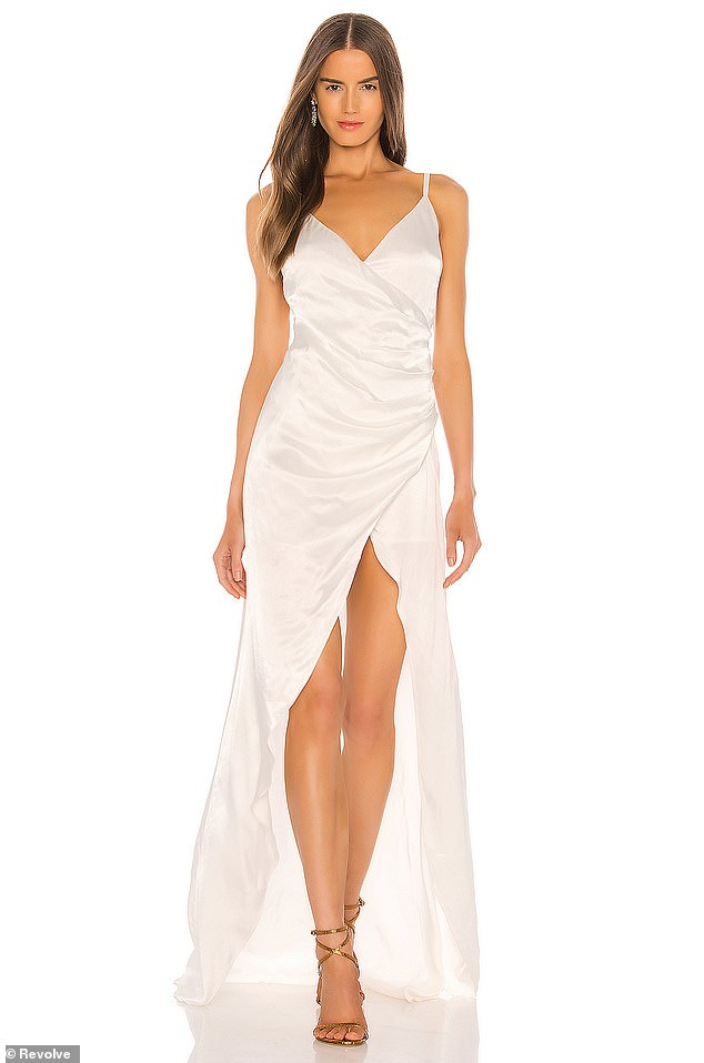 BEST IF YOU'RE FEELING SLEEK AND SEXY: Perfect for body-confident brides, this satin gown from independent label SAU LEE features a daring asymmetric hemline and ruched detailing for extra glamour. An ideal pick for destination weddings, it looks great with gold accessories
