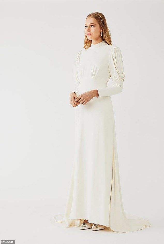 BEST FOR BRIDES WITH A TRADITIONAL FLAIR:Timeless and elegant, the Laurel dress guarantees a head-turning silhouette for your big day. The purity of its high-neck collar is offset with a dramatic, diamond-shape cut-out and keyhole detail to the back