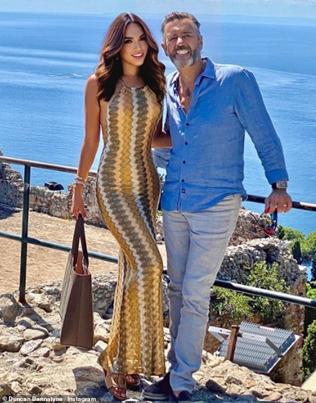 Loved-up: The Dragon's Den star has been enjoying a sun-soaked holiday in Sicily, Italy, with wife Nigora Whitehorn, 40
