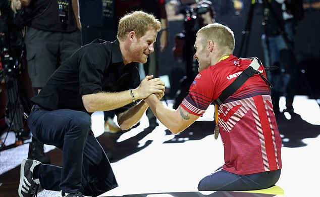 Prince Harry created the Invictus Games in 2014, he's pictured meeting Mark Ormrod of Team UK at the indoor rowing competition in 2017