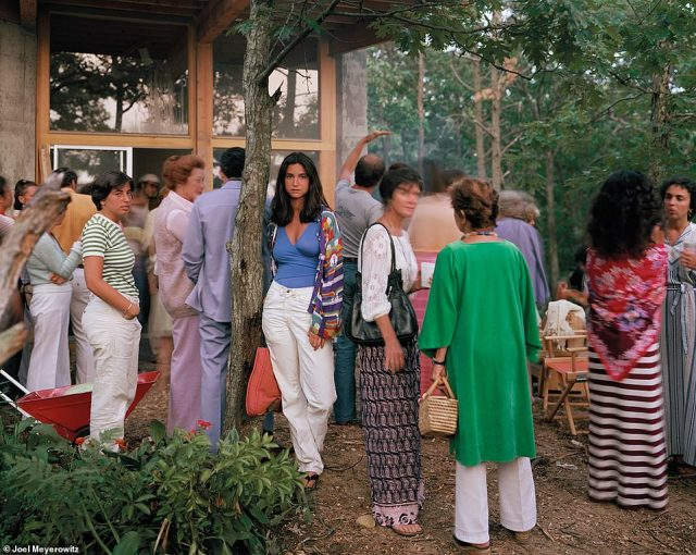 After years of taking pictures of New York City, Meyerowitz eventually chronicled other parts of the country, such as Cape Cod. For the above portrait, Wellfleet, Massachusetts, 1977, he said he had been invited to a cocktail party while his family was living on Cape Cod. By then, he had switched from a 35mm to a large format camera, which he took with him everyone. 'I see this beautiful young woman. She was just standing against the tree in a dream world,' he recalled. From across the way, he let her know that he was going to take her picture. 'She stood absolutely still,' he told DailyMail.com, adding that he only made one frame of this image