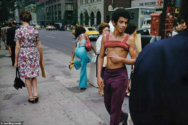 When the above image, New York City, 1974, was taken Meyerowitz had been working for about 12 years. He said he 'was trying to push the picture around so more than one thing was happening.' Meyerowitz was at 42nd Street and Fifth Avenue and noted the woman in turquoise fixing the strap of her bright yellow heel, the pink busy design of the woman on the left who seemed to be in line, and the man's plum pants and rolled-up coral tank. 'The mix and the mess and the chaotic engagement was interesting to me,' he told DailyMail.com. 'It was so exciting back then. I was really on fire'