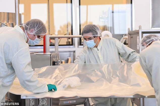 Scientists at the CSL Biotech facility in Melbourne on Sunday. Health Minister Greg Hunt said a vaccine would likely be ready by the first quarter of next year