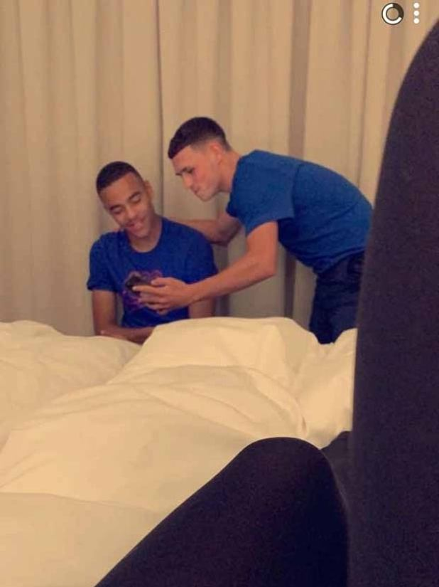 The young couple were photographed in hotel rooms by girls who stayed to meet them