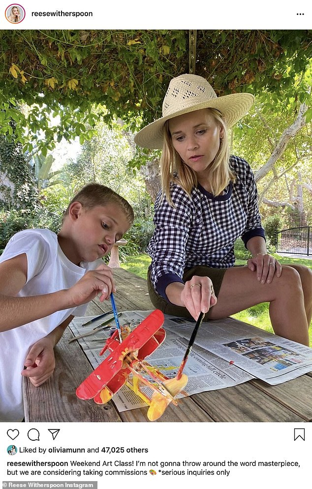 Hands-on mom:Reese Witherspoon of The Morning Show with Jennifer Aniston was seen doing crafts with her son Tenneesee in the backyard of their home; she also has son Deacon as well as daughter Ava