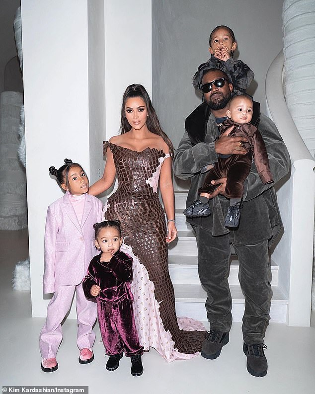 Happy families: 'Kimye' married in Florence six years ago and share four children - North, seven, Saint, four, Chicago, two, and Psalm, one.(pictured above Christmas Eve 2019)