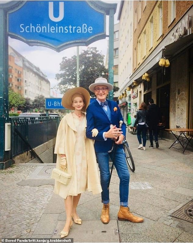 On the go! The couple stopped for a quick photograph after using Berlin's public transport. Even when getting on a train, the duo looked trendy