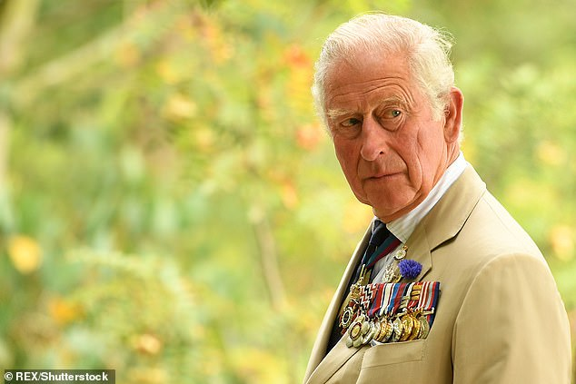 Prince Charles reacts during a national service of remembrance at the National Memorial Arboretum in Alrewas, central England on August 15, 2020