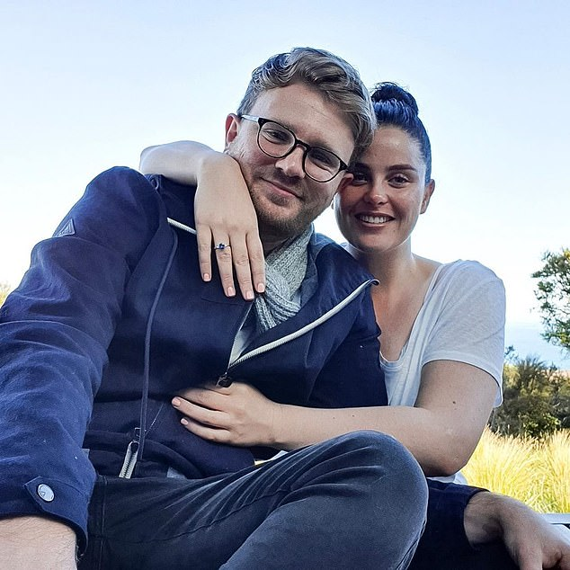Dubber (right) and Mr McDonald (left) pictured with their engagement ring in 2019