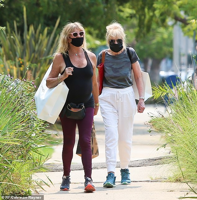 Birthday presents? Oscar winner Goldie Hawn (L) and a gal pal shopped together at clothing boutique Vince inside the Palisades Village strip mall in the Pacific Palisades on Monday