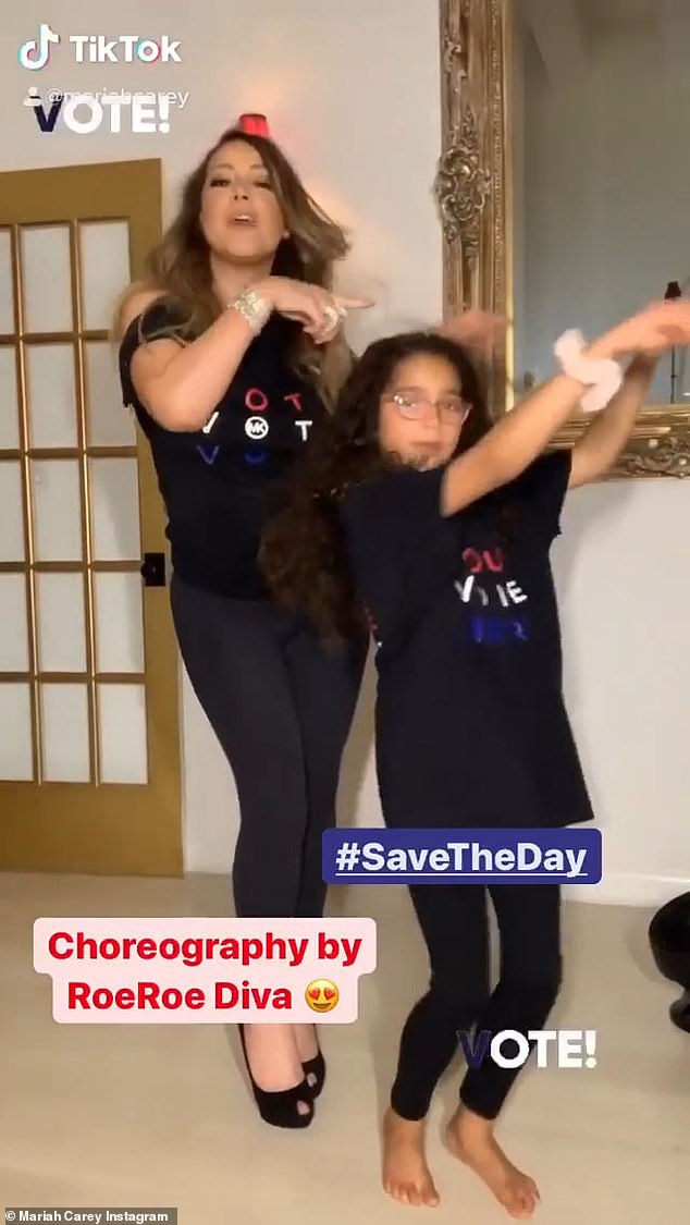 Moving in stereo: The mother-daughter duo did a choreographed dance and sing-a-long to Carey's new socially-conscious song Save The Day