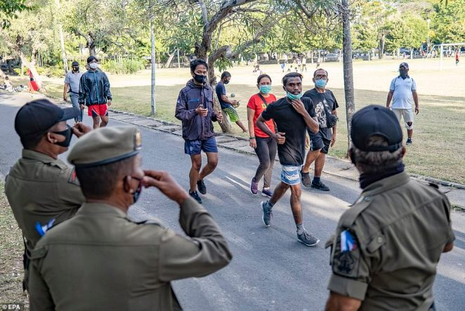 Residents are seen exercising with face masks in Denpasar in Bali this week. Indonesia has recorded more than 197,000 COVID-19 cases and 8,000 deaths