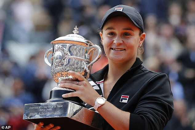 Ash Barty (pictured after winning the 2019 French Open) will not defend grand slam crown