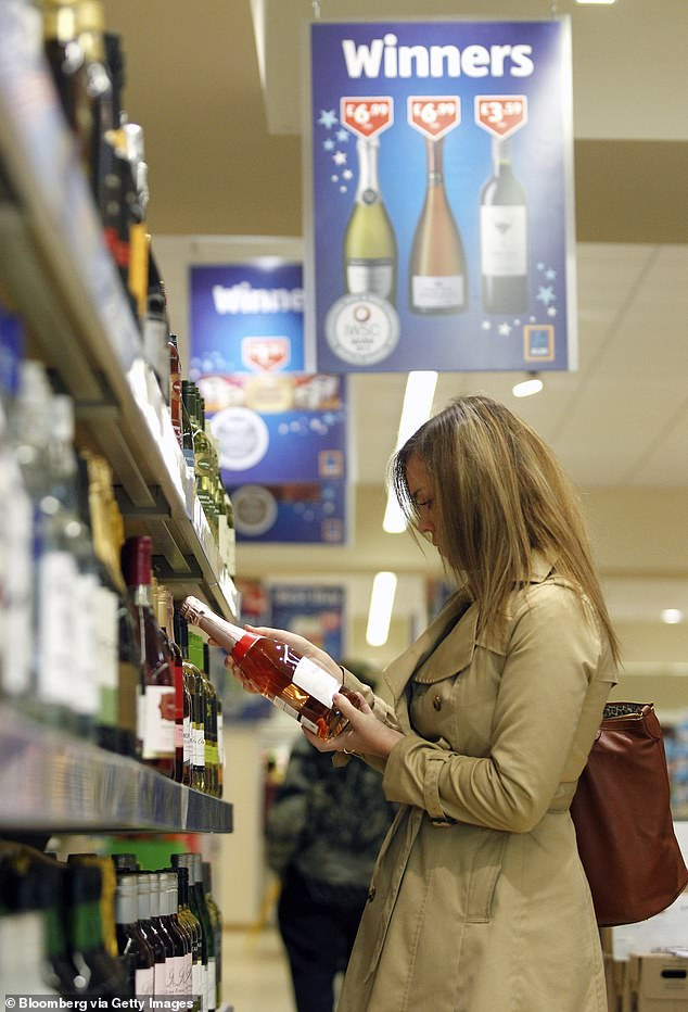 A shopper has been left 'embarrassed' over a little-known alcohol policy after she tried to buy a bottle of red wine at Aldi with her two teenage kids in tow (file image)