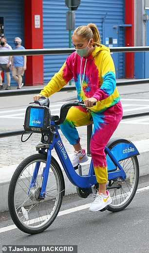 Primary colors: The 51-year-old pop diva sported a red, yellow, and green tie-dye hoodie, matching joggers, and white Nike sneakers for her exercise session