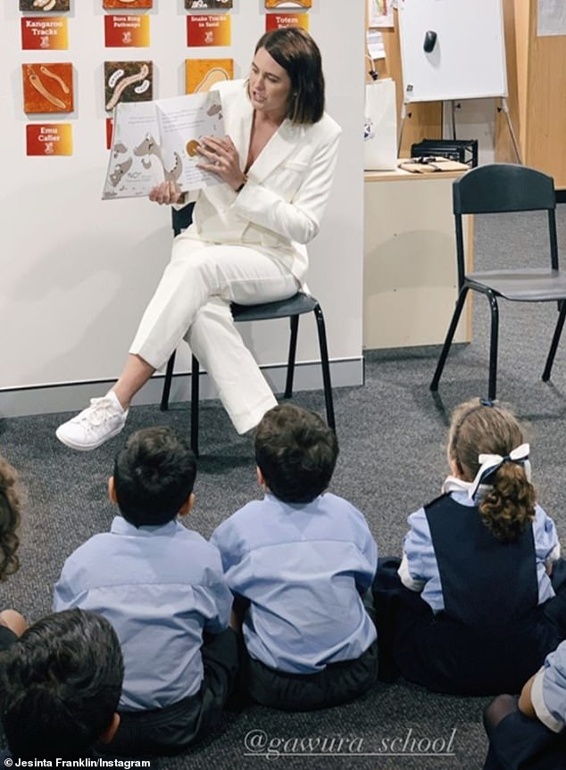 Helping hand: Earlier in the day, Jesinta visited Gawura School, a school for Aboriginal and Torres Strait Islander children in Sydney's CBD