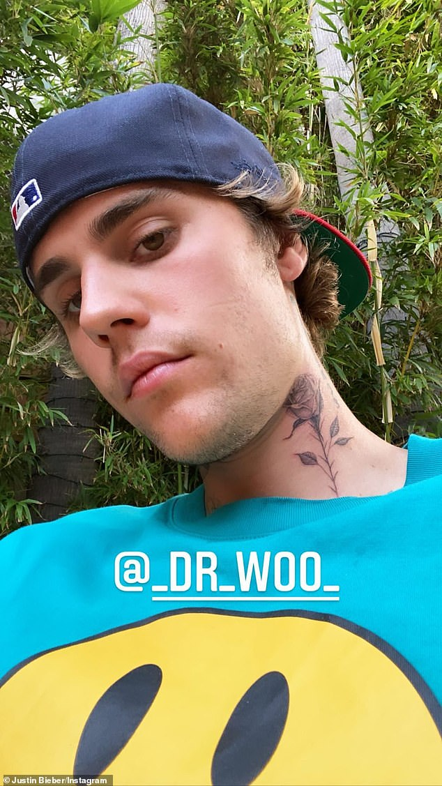 New addition: Justin Bieber paid a visit to his favorite tattoo artist Dr. Woo on Monday afternoon