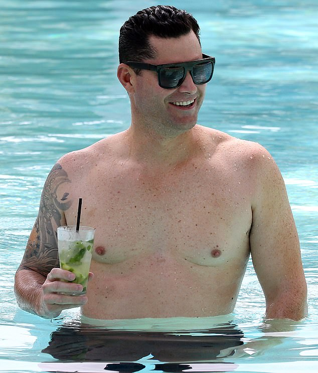 All smiles: Jamie Doran (pictured) looked smug as he enjoyed a swim in Queensland on Monday as the future of Channel Ten's Bachelor In Paradise hangs in the balance