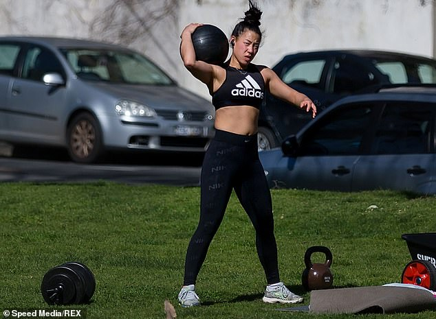 Victorians are banished from gyms until December following the state's second horror wave of coronavirus infections. Pictured is a woman getting her daily dose of exercise in Melbourne