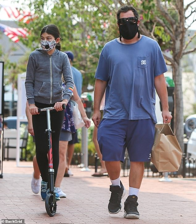 Casual style: The 53-year-old actor wore a loose blue T-shirt and baggy blue shorts while grabbing lunch in the Pacific Palisades area with his daughter