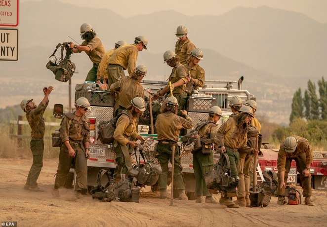 Firefighters stop along Oak Glen Road while working the El Dorado Fire in southern California on Monday