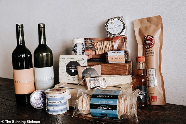 Customers in Sydney can now indulge in hampers of creamy cheese and delicious wine to be delivered to their doorstep (Big Aussie Hamper pictured)