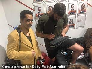 Famous: One image shared to Facebook shows the former Australian Survivor star signing a black piece of cardboard with a metallic marker