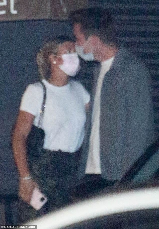 Covered up:In accordance with current safety guidelines, both wore protective face masks as they exited the eatery later that night