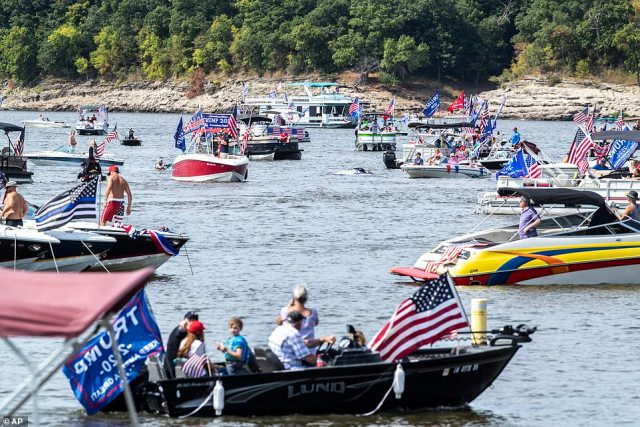 Supporters of President Donald Trump have decorated their boats with flags during a Labor Day boat parade at the Coralville Reservoir in Iowa
