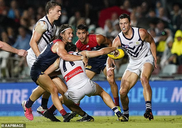 James Aish is tackled by Melbourne Demon's Ed Langdon during the Dockers 14-point win on Monday night