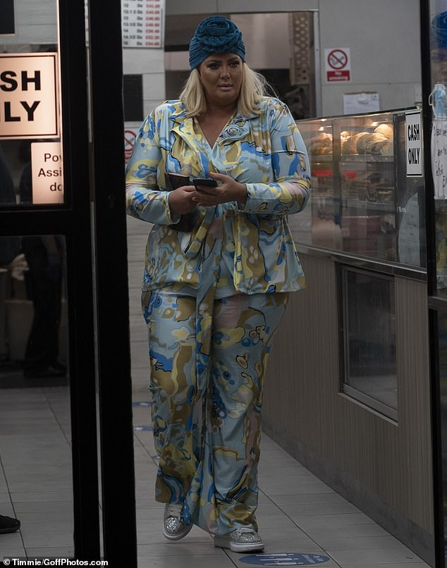 Bold: Gemma commanded attention in her bold blue patterned ensemble on Monday