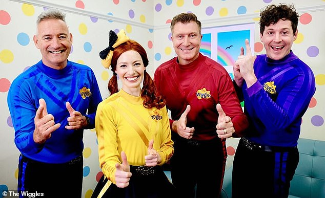 'Well, I'll tell you what, I will never complain about wearing a skivvy ever again!' he joked after taking off his mask. Pictured second from right with The Wiggles