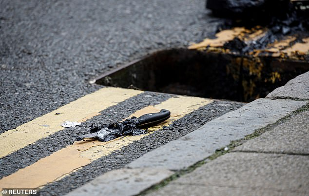 Pictures from Sunday show a knife which has been dug out from a drain in Edmund Street by police who are investigating the stabbings in Birmingham