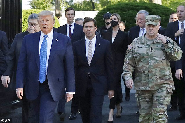 Trump's comments were seen as suggesting top military leaders were behind an article in The Atlantic, which reported he made disparaging comments about U.S. troops - above the president is seen with Defense Secretary Mark Esper and Chairman of the Joint Chiefs of Staff General Mark Milley on June 1 as Trump walked to St. John's church for a photo-op