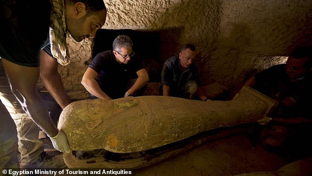 Located 19 miles south of Cairo, the vast burial complex — which features the step pyramid of Djoser and flat-roofed tombs — served the ancient capital of Memphis. Pictured, experts with theEgyptian Ministry of Tourism and Antiquities carefully open one of the coffins