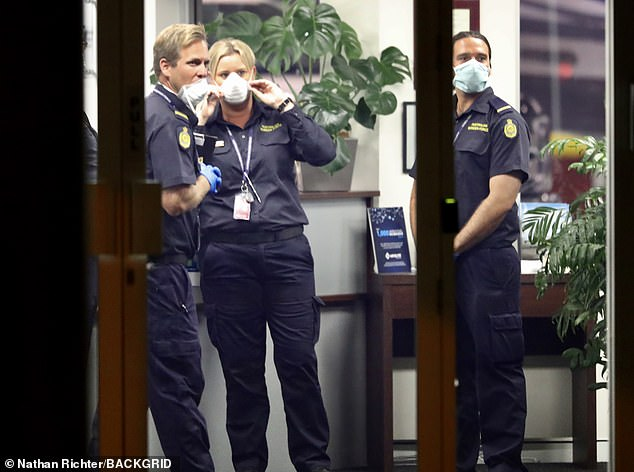 Assistance: Tom was met by Queensland health officials at the airport and had a police escort to the Oracle Resort in Broadbeach