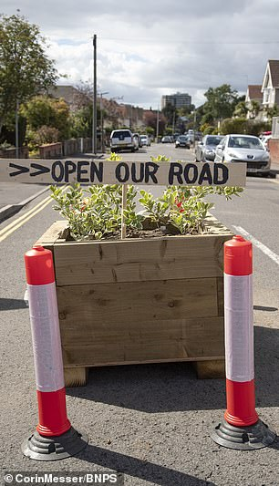 The wooden signs put on Churchfield Road in Poole have been removed by council workers, who claim they could injure cyclists
