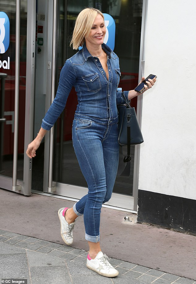 Finishing touches:The Smooth Radio presenter added to her look with a large blue leather handbag, while battered white running shoes gave the overall ensemble a causal flourish