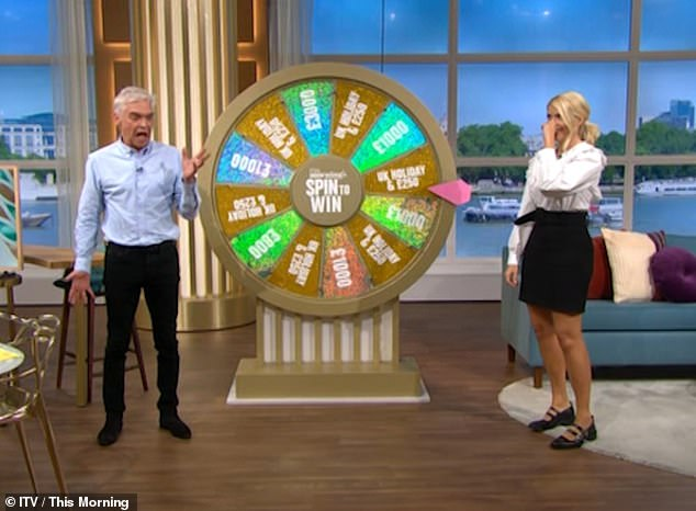 Oops! Phillip Schofield stunned This Morning viewers on Tuesday, when he mistakenly informed a viewer that he'd won £250,000 instead of £250. Pictured with Holly Willoughby