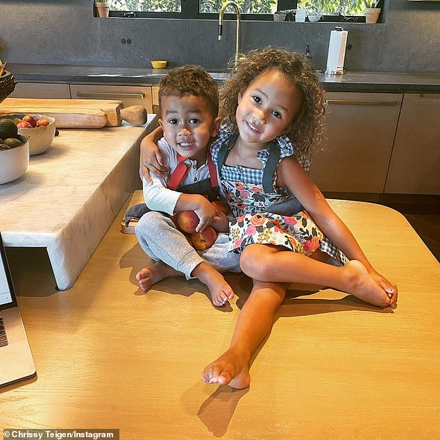 Her little ones: Though she is not often on social media any longer she did post a shot of kids Miles and Luna in her kitchen this week