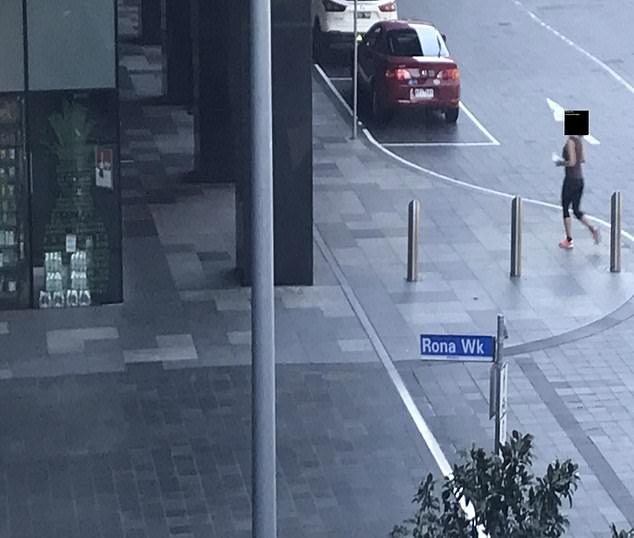 Guests were pictured strolling out of the hotel unchecked next to a street sign fittingly named 'Rona Walk'