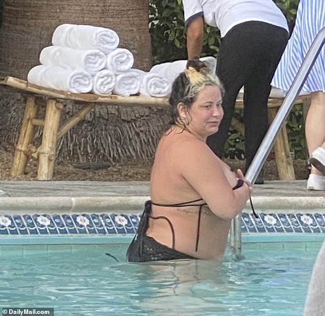 Aubrey O'Day was spotted in a bikini at the Holiday House hotel pool in Palm Springs after claiming photos of her looking unrecognizable are fake