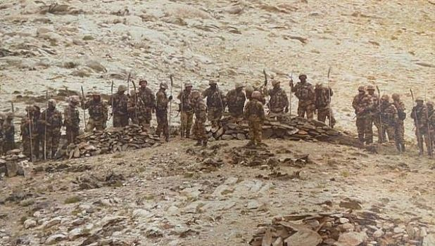 Armed with a spear: Chinese troops near the disputed Himalayan border with India this week where shelling is banned, but in June the troops wage a deadly war